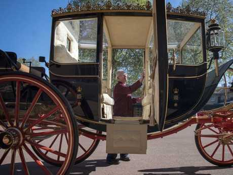 They will take a 25 minute ride through the city in this carriage. Picture: Victoria Jones/Pool via AP.