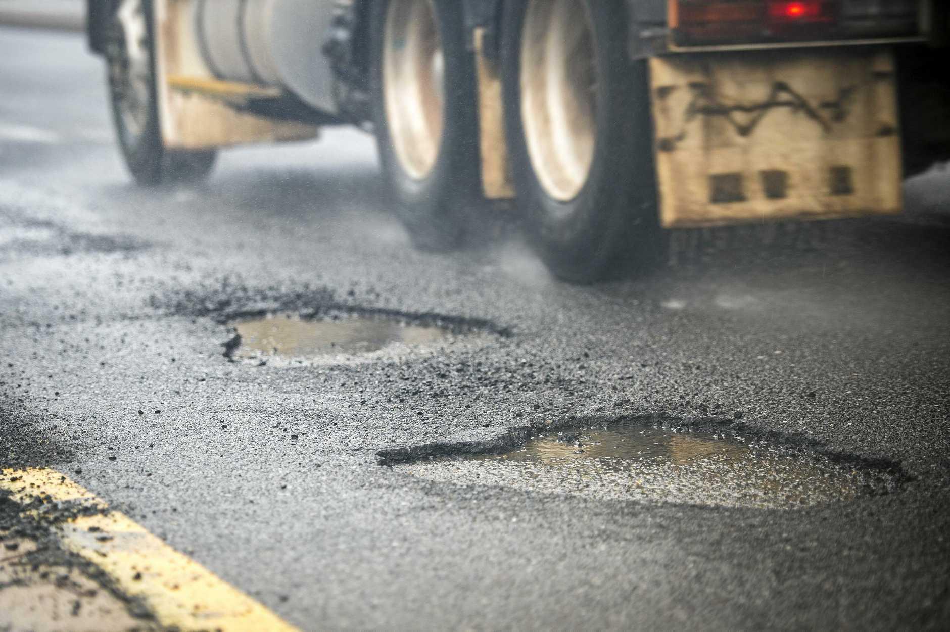 HAZARD: Potholes after heavy rain on Toolooa Street, Gladstone.