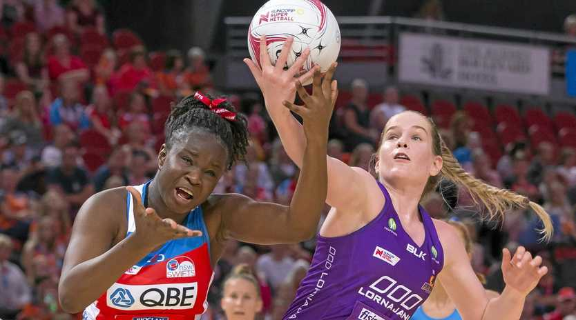 Sam Wallace of the Swifts and the Firebirds' Tara Hinchliffe compete for possesion in their sides' round one clash last Sunday. Picture: Craig Golding/AAP