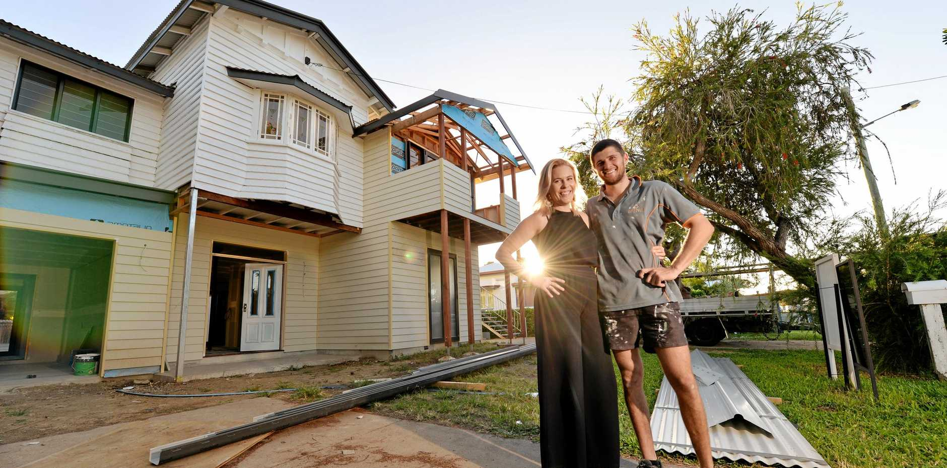 UNDER CONSTRUCTION: Mackay house-flippers Madison Strutynski and Michael Cotter at their Hunter St, West Mackay property.