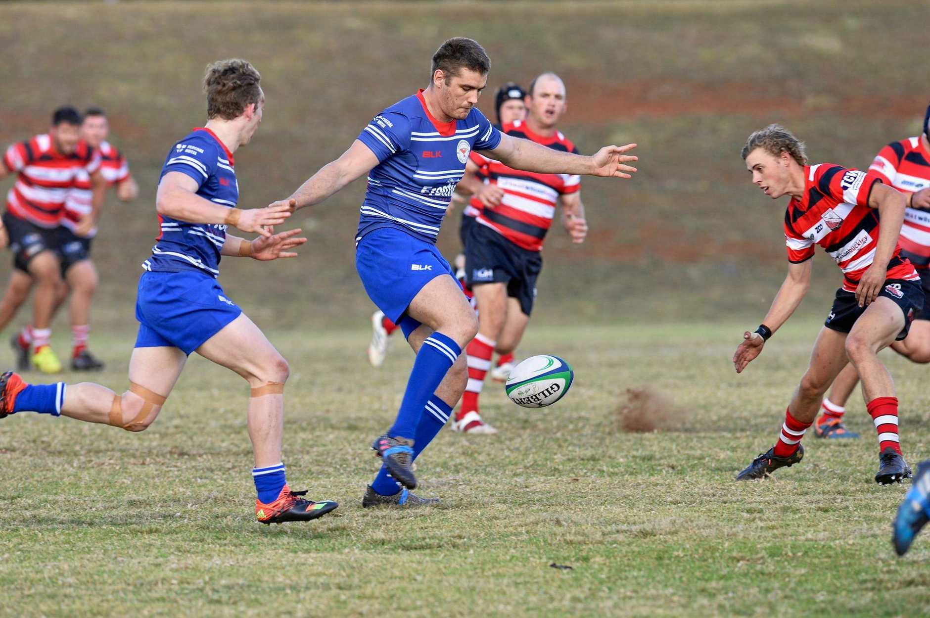 USQ centre Andre van Staden kicks ahead for team-mate Sam Lewis (left) to regather and score Saints first try in their round-six Risdon Cup win over Toowoomba Rangers today at USQ Rugby Oval.
