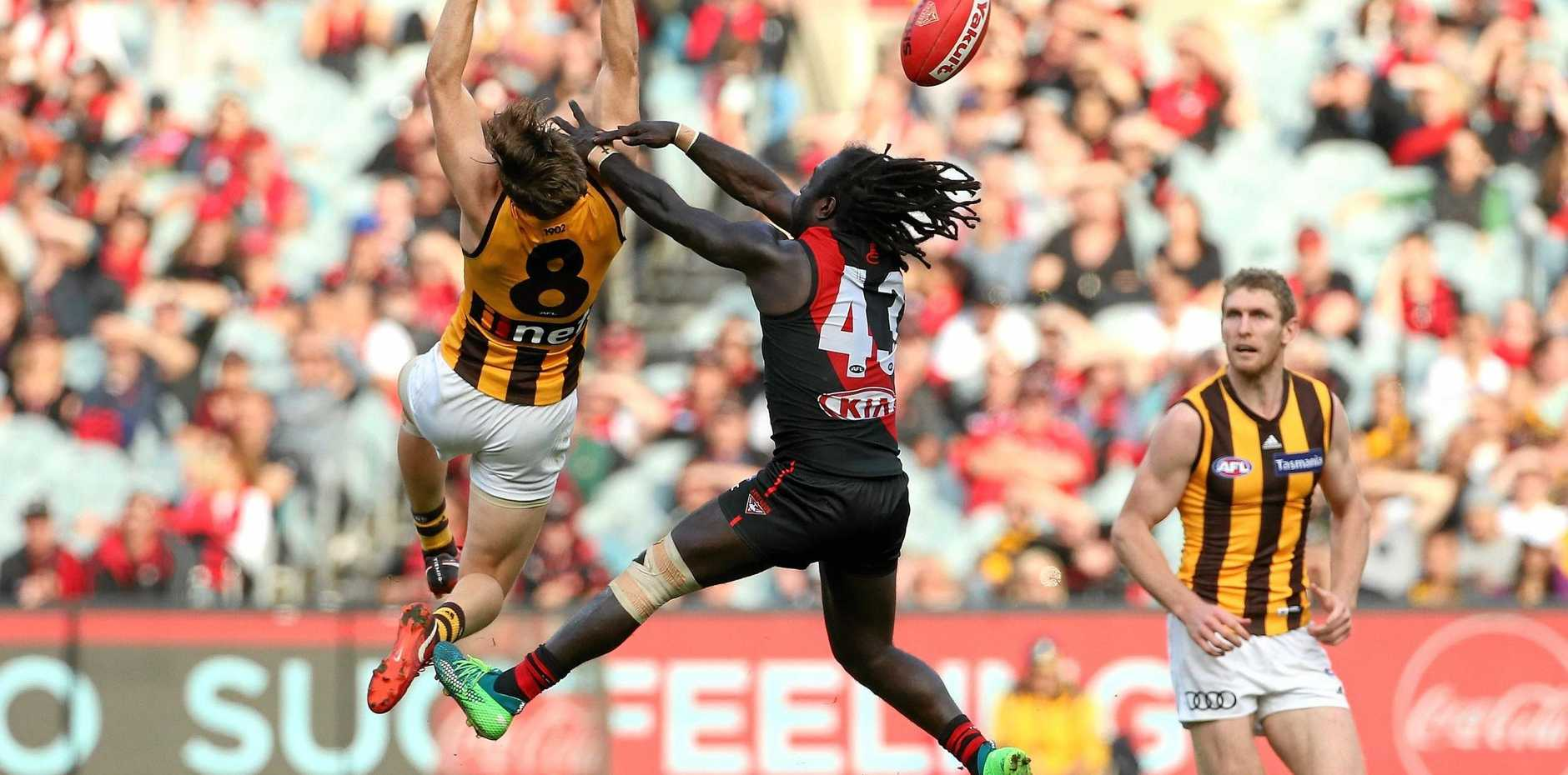 Hawthorn's Taylor Duryea attempts to mark in front of Essendon's Anthony McDonald-Tipungwuti at the MCG on Saturday. Picture: Hamish Blair/AAP