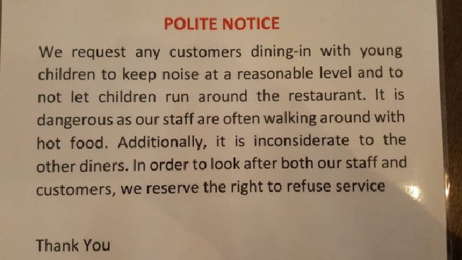 A family were shocked when they went to a curry house and were handed this laminated notice. Picture: SWNS