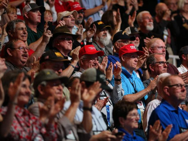 People cheer for President Donald Trump during the NRA convention. Picture: AFP