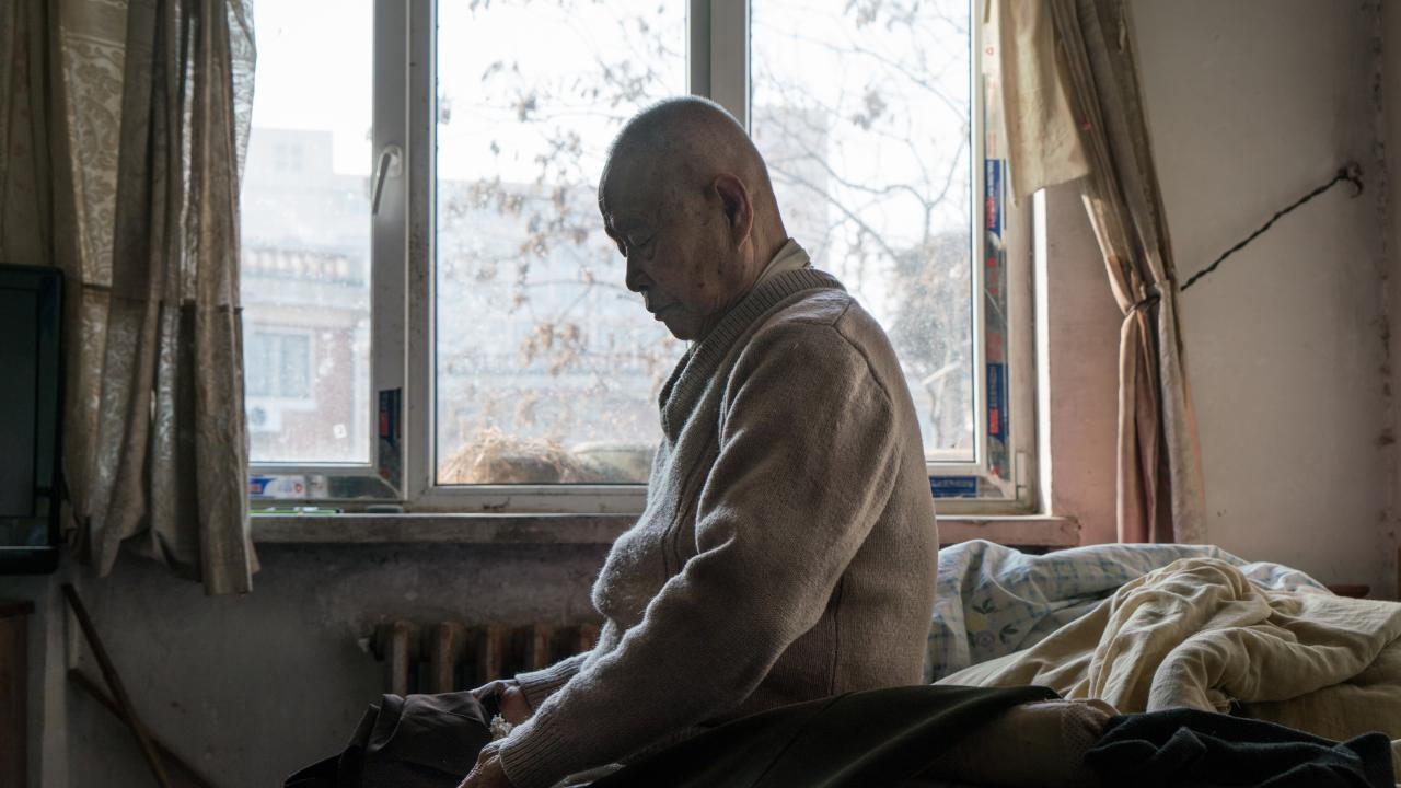 Han Zicheng was 85 when he wanted to be adopted because he feared dying alone. (Photo by Yan Cong for The Washington Post via Getty Images)