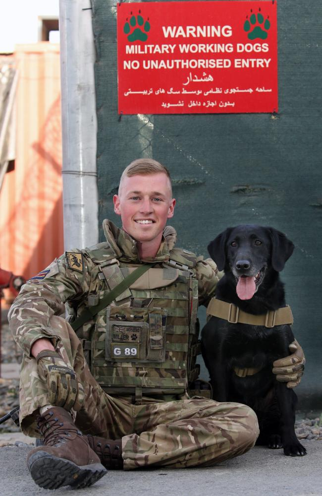 Private Jon Miller, 27, and his Labrador Lilly. Picture Gary Ramage