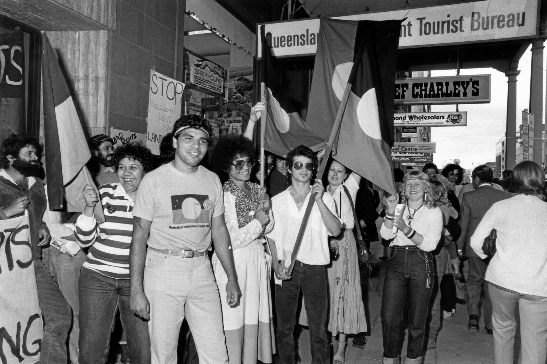 A group of Aboriginal Australians at rally lead by Warren Mundine, chairman of the Justice Before Games support group, demonstrating in front of the Queensland Tourist Bureau office in Grenfell Street, Adelaide 17 Sep 1982.