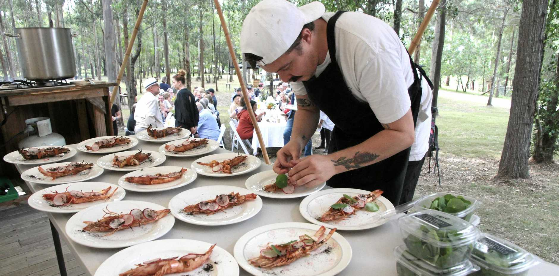 Chef Zac Roberts prepares plates for the patrons at Feast in the Field at Solum Farm on Saturday.
