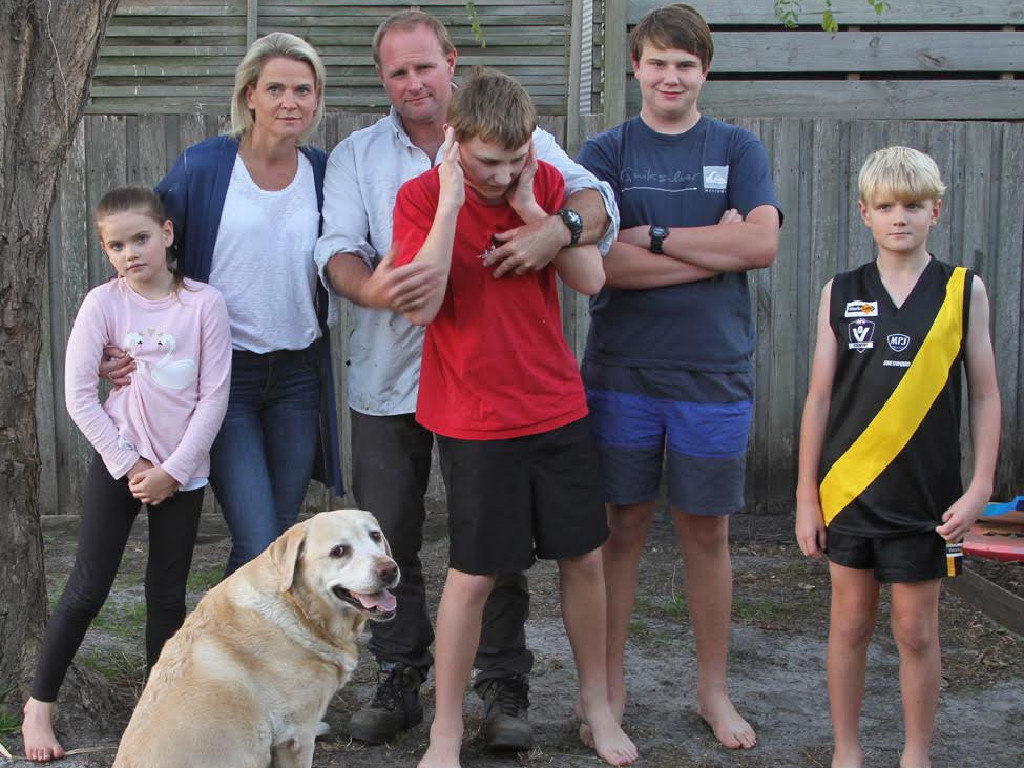 Liz and Sean Whelan with their children Georgia, Max, Thomas and Harrison, and pet dog Kimba. Picture: Katie Brannaghan