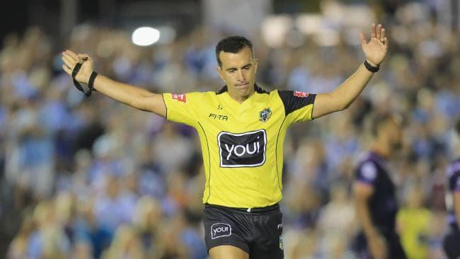 Referee Matt Cecchin awards a penalty.
