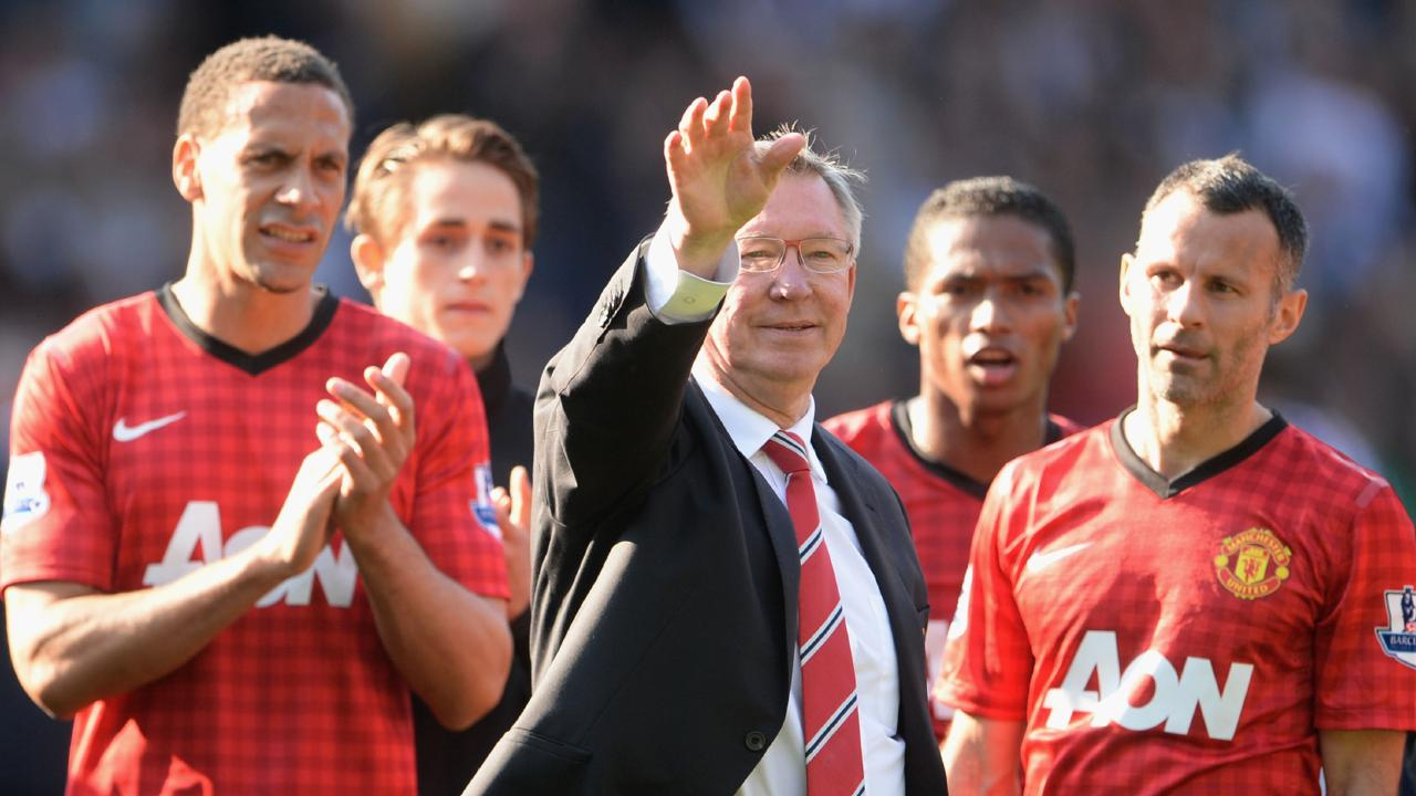 Manchester United manager Sir Alex Ferguson is applauded by players Rio Ferdinand and Ryan Giggs after his 1,500th and final match in charge of the club.
