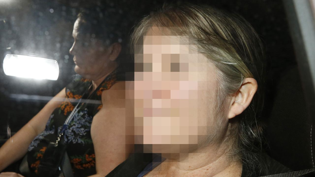 The woman was extradited on Saturday evening. She is charged with abducting her twin daughters four years ago from Townsville. Picture: AAP/Josh Woning