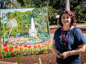 fOREVER FLOWERS: Artist Anna Bartlett with the painting she has been working with horticulturists on to capture exactly what Queens Park will look like in full bloom. It will be auctioned at the Qantas Gala Dinner which opens the festival.