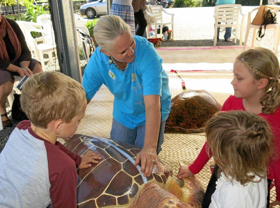 WILDLIFE WARRIORS: Expert Sherida Holford measuring turtles.