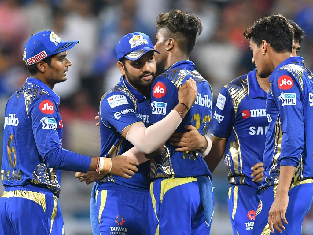 Mumbai Indians captain Rohit Sharma (2L) celebrates with Hardik Pandya (C).