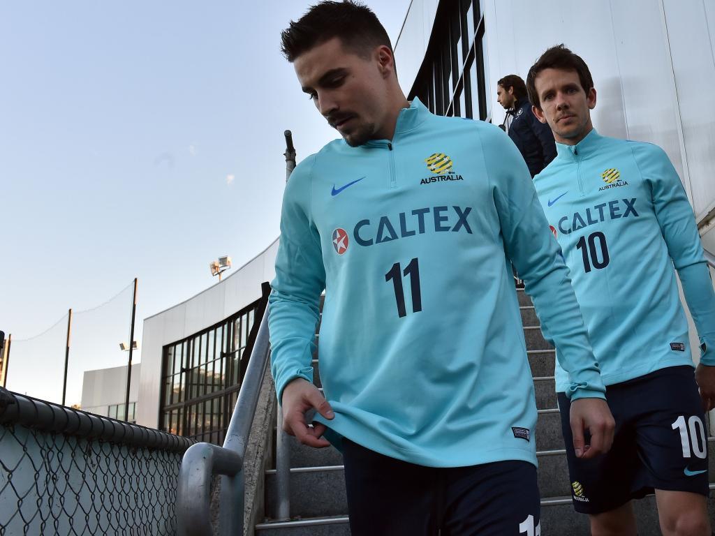 Jamie Maclaren (left) is back in the World Cup reckoning.