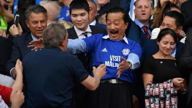 Cardiff owner Vincent Tan and manager Neil Warnock celebrate promotion to the premier league