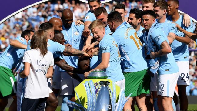 Alexander Zinchenko of Manchester City looks on as the Premier League trophy falls off its stand