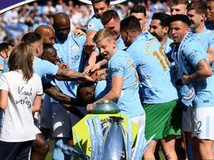 City lift the Premier League trophy... and knock it over