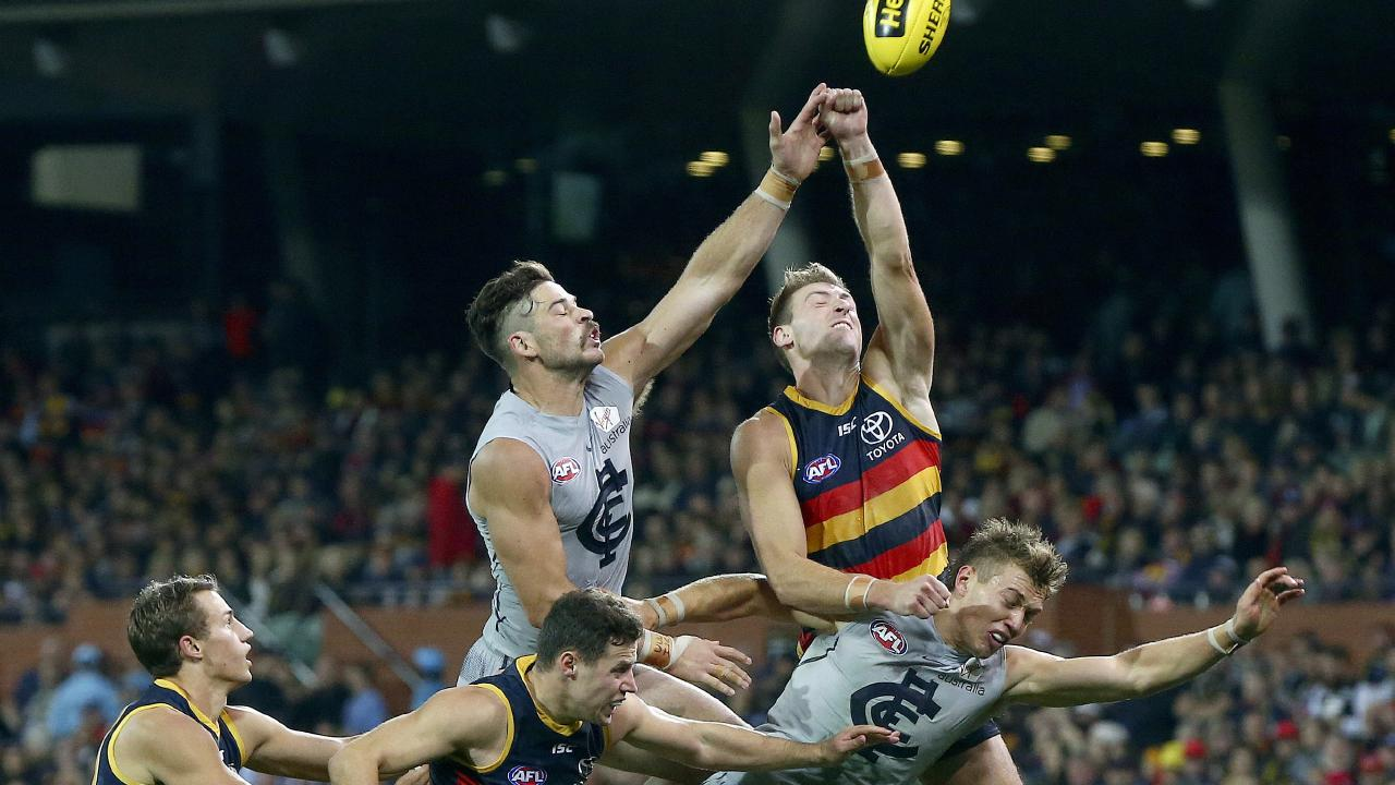 Adelaide's Daniel Talia, right, and Carlton's Levi Casboult, left, contest the ball at Adelaide Oval. Picture: Sarah Reed Crows press conference