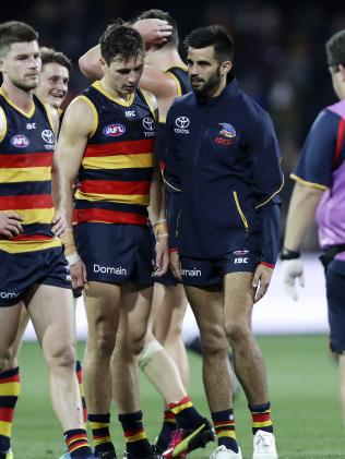Wayne Milera grabs at his leg after injuring himself against Carlton on Saturday night. He failed to return to the field in the second half. Picture: Sarah Reed