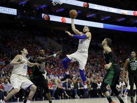 Philadelphia 76ers' Ben Simmons puts up a shot as he notches a double-double.