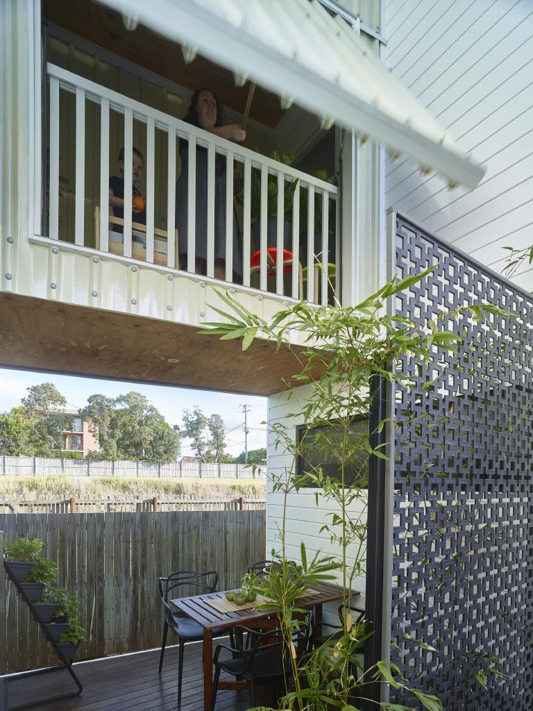 HELLO: The wall of the upstairs covered walkway can be opened to allow easy communication if someone is using the outdoor area downstairs.  Designers: Kirsty Volz and David Toussaint Builder: Thallon and Mole Photography: Scott Burrows