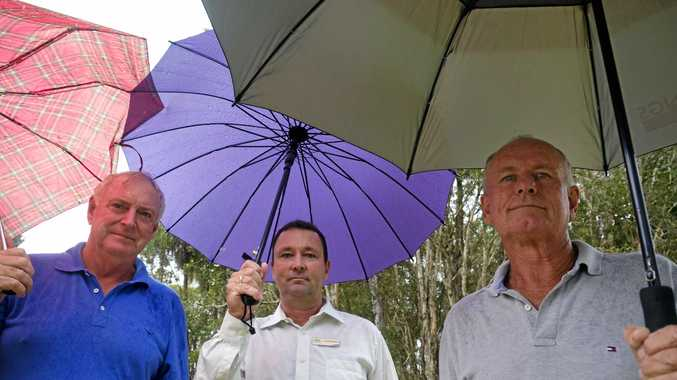 HAD ENOUGH: Moore Park Beach resident Russell Stewart with Bundaberg Regional Councillor Jason Bartels and  Grant Errington hold concerns about the roads to the seaside community which are dangerous and flood, leaving the community stranded.