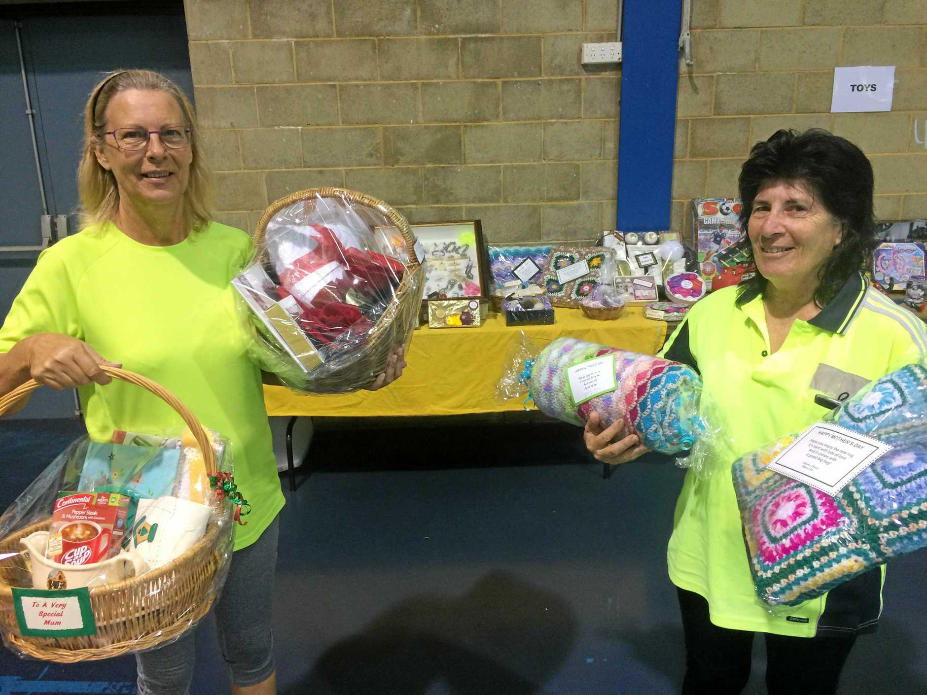 GIFTS GALORE: Lifeline Shops Fraser volunteer supervisor Kim Franks and volunteer of six years MJ White have a number of Mother's Day gift baskets and present ideas you can pick up at the Bookfest.