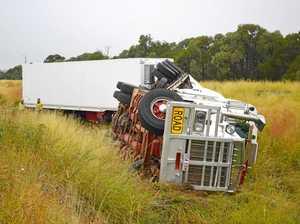 Truck rolls over on Warrego Highway