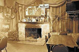 TOASTY AMBIENCE: The fireplace at Silky Oak Tea Gardens is a welcome spot for diners in the winter months.
