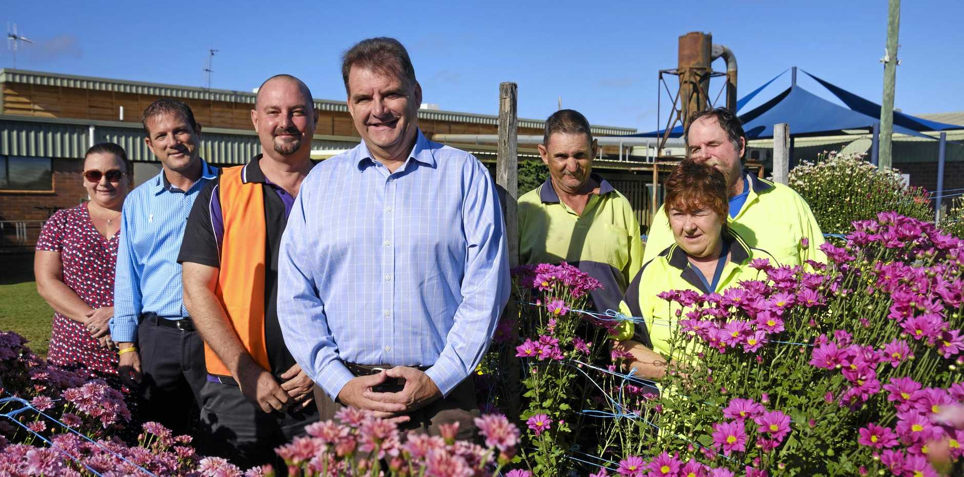 FLOWERS FOR MUM: Rowena Hanlon, David Batt, Robert Campbell and Stephen Bennett with Endeavour workers Gavin Chapman, Wayne Horton and Kaylene Sharkey.