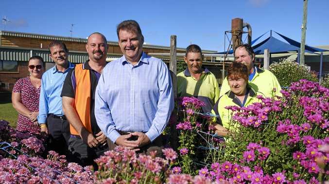 FLOWERS FOR MUM: Rowena Hanlon, David Batt, Robert Campbell and Stephen Bennett with Endeavour workers Gavin Chapman, Wayne Horton and Kaylene Sharkey.