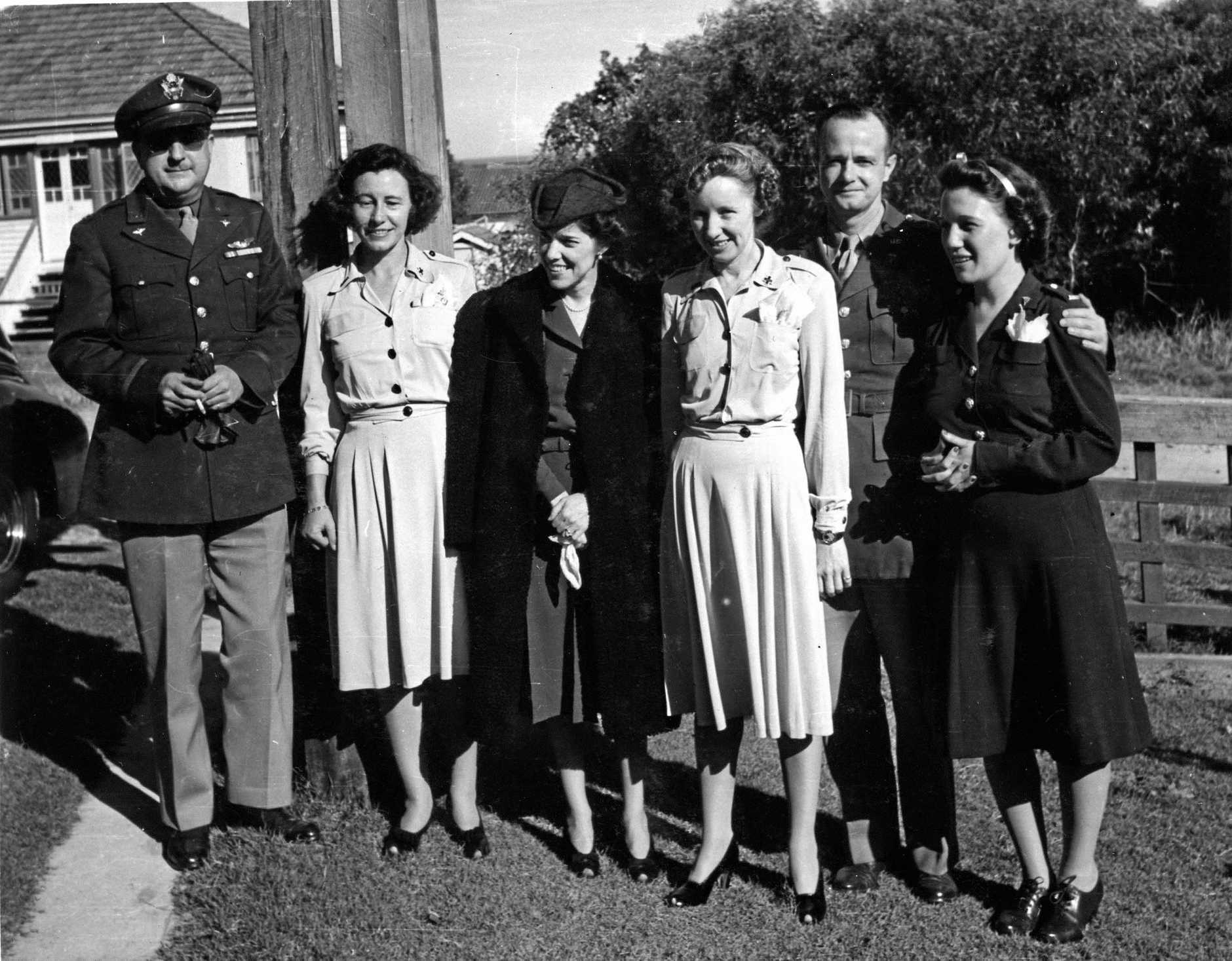 American Army Officers and United States Red Cross and American army nurses are pictured with Jean MacArthur (centre), wife of General Douglas MacArthur, outside Strathallan Guest House, Caloundra, in 1944.