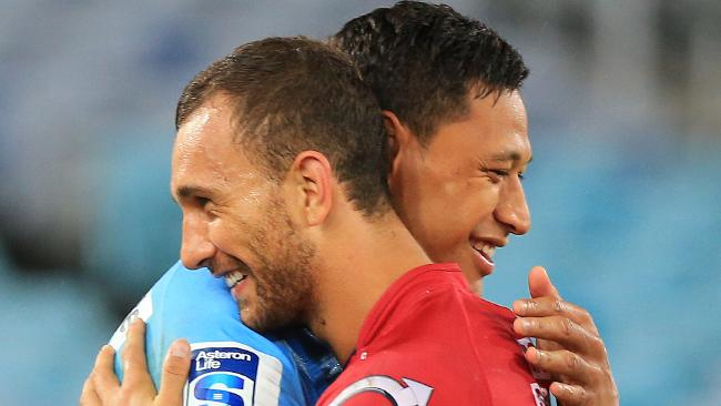 Israel Folau and Quade Cooper after a Super Rugby match between the Waratahs and Reds. Picture: Mark Evans