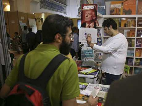A poster advertising the farsi translation of the book Fire and Fury by Michael Wolff on sale at the International Book Fair, in Tehran. Picture: AP Photo/Vahid Salemi