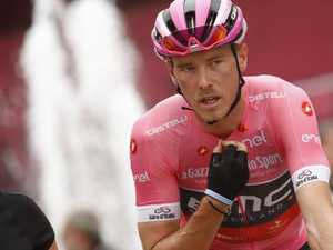 Dennis hangs tough to stay in pink at Giro