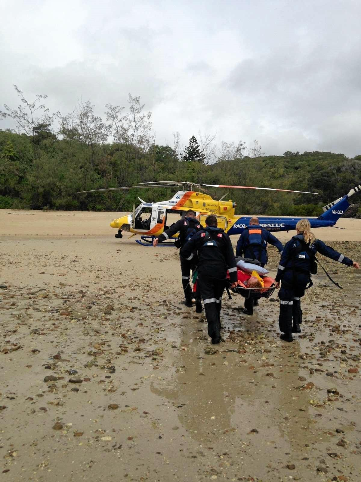 RACQ CQ Rescue crew airlifts Henry Moore from a remote beach on Whitsunday Island after he was stung by a cone snail. Photo: Contributed