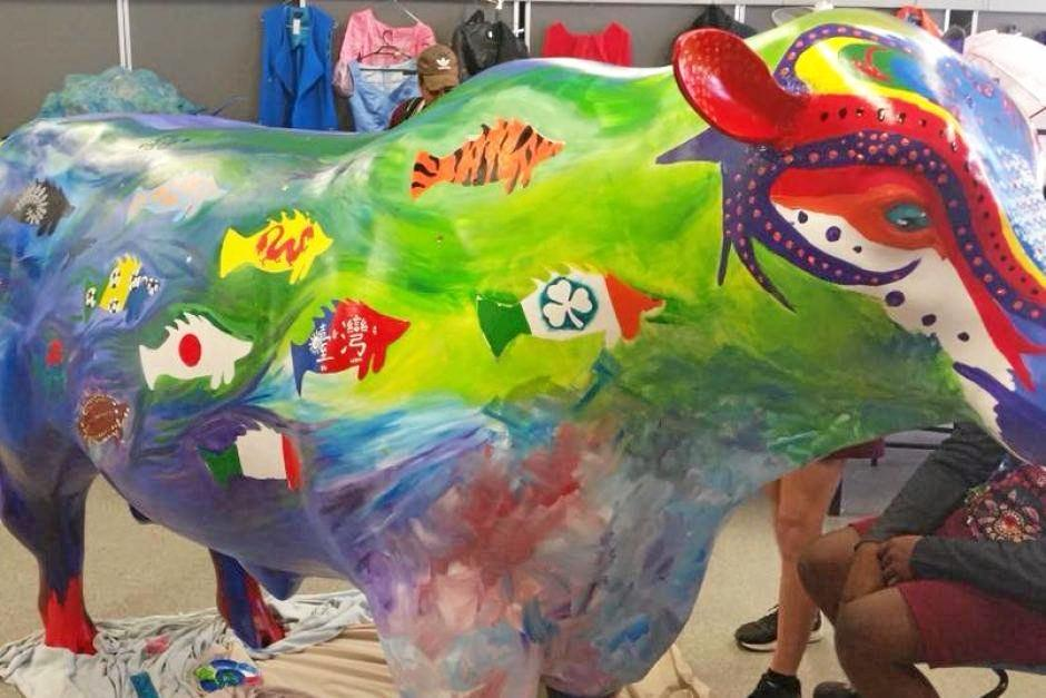 BEFORE: North Rockhampton High School students, siblings Amber Jun Xie and lu Ting Xie, were disappointed to discover the Taiwanese flags they had painted on a bull statue were painted over by the Rockhampton Regional Council.