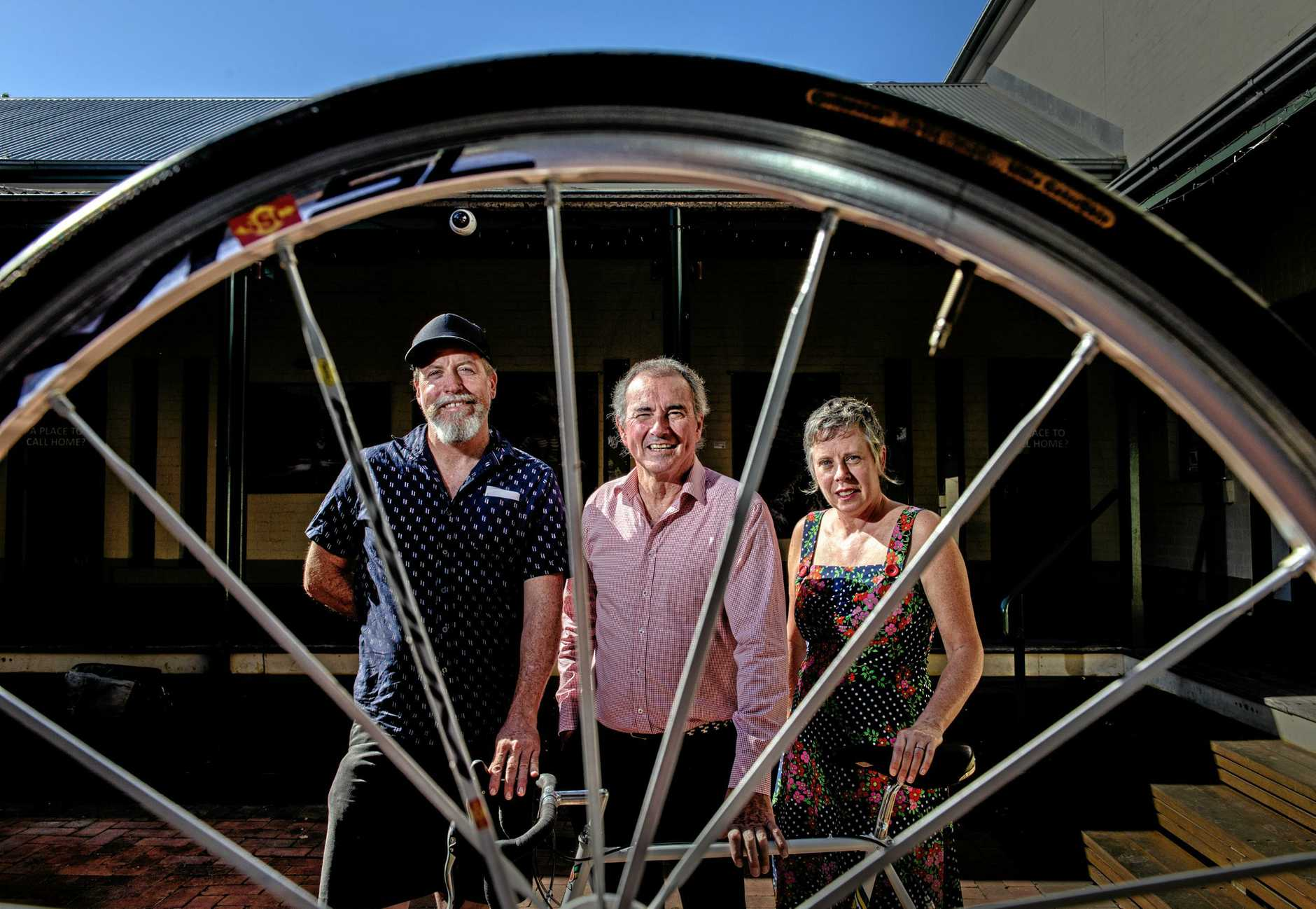 BIG WHEELS: Member for Clarence Chris Gulaptis with Danny Loyden and Sammy Lovejoy of Cast Net productions on the announcement of funding for the Bike Town project in conjunction with Grafton Regional Gallery.