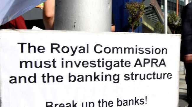 A photo taken in Melbourne shows a placard outside the royal commission set up in February to investigate misconduct in the banking sector. Picture: AFP