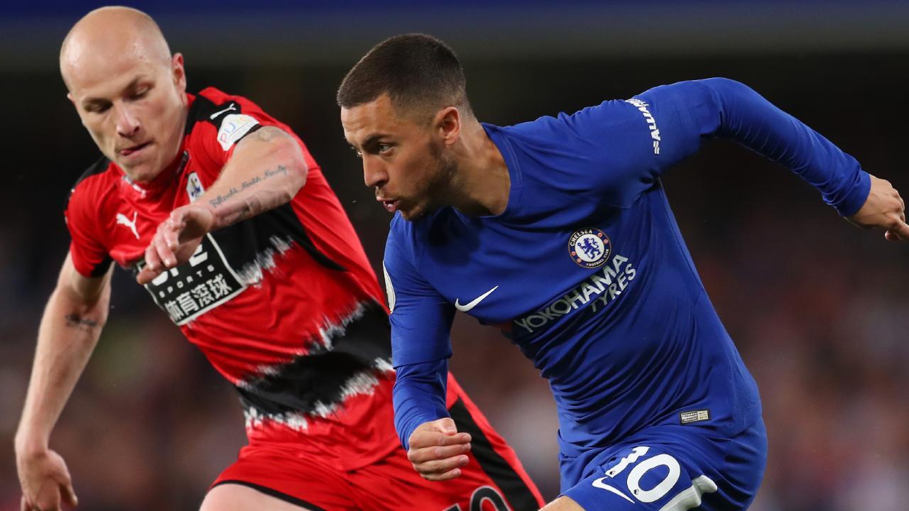 Aaron Mooy keeps a close eye on Chelsea dangerman Eden Hazard.