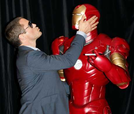 Actor and musician Robert Downey Jr. with a statue from his latest movie during a red carpet event at the Australian premier of the movie Iron Man in Sydney, Monday, April 14, 2008.