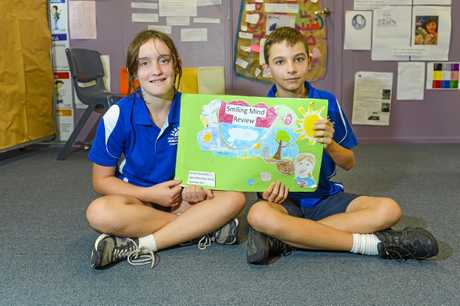 Ruth Norton and Lachlan Buchanan show the book students have put together which offers feedback on the Smiling Minds program.
