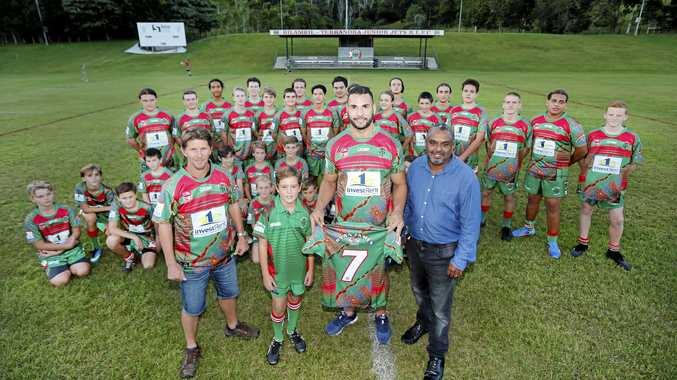 JERSEY PIONEERS: The Bilambil Jets will be the first club in Group 18 JRL to don indigenous jerseys when the under-12s and under-16s run out in their new jumpers tomorrow. Titans captain and Bilambil Junior Life Member Ryan James (centre) and local artist Rob Appo (right) presented the juniors with their jerseys on Thursday.