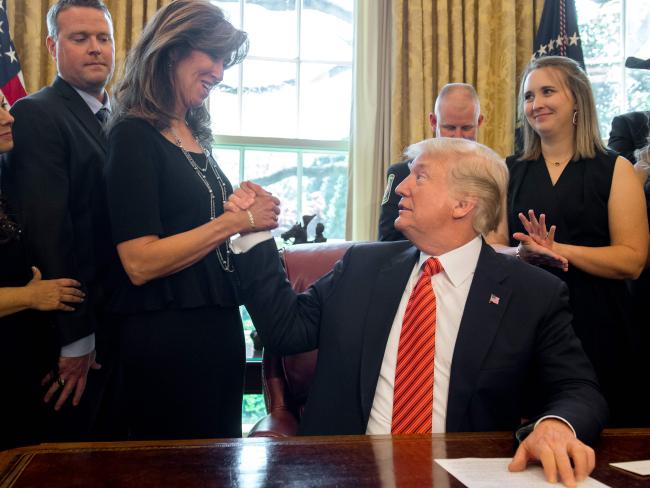 Donald Trump greets Tammie-Jo Shults at the White House. Picture: AFP/Saul Loeb