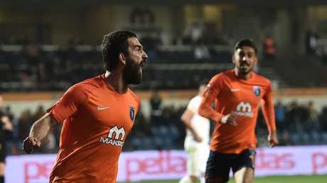 Basaksehir's Arda Turan (L) celebrates after scoring a goal.