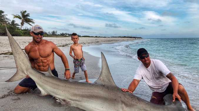 Elliot Sudal and the hammerhead shark he caught over the weekend in Florida. (Elliot Sudal)