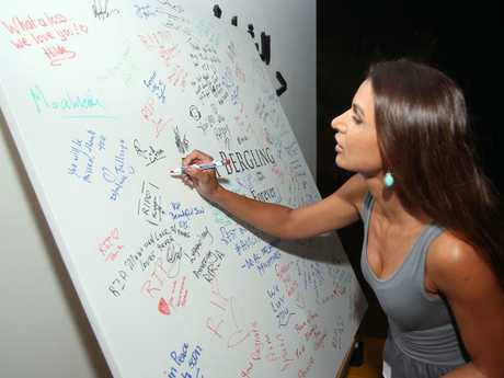 A fan signs a remembrance poster for Avicii in Oman, where he died. Picture: AFP/Mohammed Mahjoub