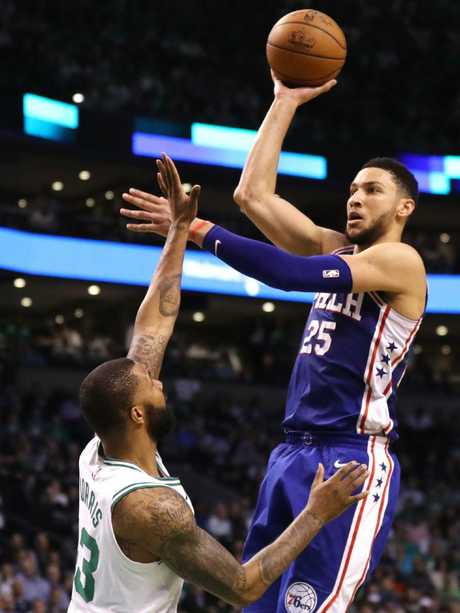 Ben Simmons shoots over Marcus Morris.